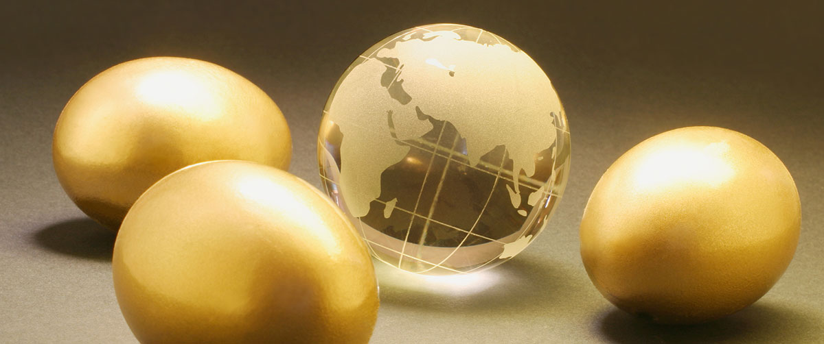 crystal globe surrounded by golden eggs
